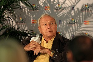 Arnold Palmer rolls his eyes after a reporter referred to Tiger's age during the Arnold Palmer Invitational on Wednesday at Bay Hill Lodge and Club.