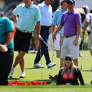 Justine Reed, center, watches her husband Patrick Reed, hit bunker shots at the Arnold Palmer Invitational on Wednesday at Bay Hill Lodge and Club.
