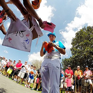 Rickie Fowler signs autographs after playing in the pro-am during the Arnold Palmer Invitational on Wednesday at Bay Hill Lodge and Club.