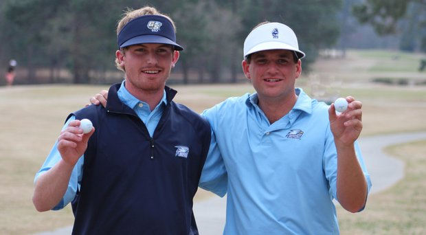 Georgia Southern seniors Hayden Anderson and Will Evans display their hole-in-one balls at the Schenkel Invitational.