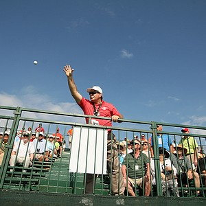 Spectator security volunteer, Samuel J. Donato, tosses Davis Love III's ball back from the stands at No. 18 at the Arnold Palmer Invitational during Round 1 at Bay Hill Lodge and Club.