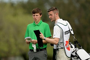 Matthew Fitzpatrick with his caddie at the Arnold Palmer Invitational during Round 1 at Bay Hill Lodge and Club.