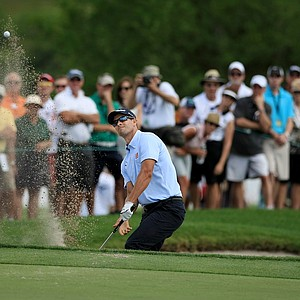 Adam Scott hits a plugged bunker shot at No. 7 during Round 2 of the Arnold Palmer Invitational at Bay Hill Lodge and Club.
