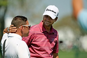 Sean O'Hair works with Sean Foley prior to Round 2 of the Arnold Palmer Invitational at Bay Hill Lodge and Club.
