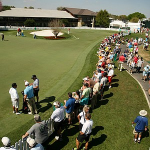 Spectators line up around the practice putting green during Round 2 of the Arnold Palmer Invitational at Bay Hill Lodge and Club.