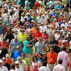 Crowds of people walk around during Round 2 of the Arnold Palmer Invitational at Bay Hill Lodge and Club.