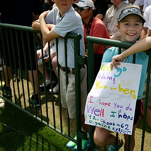 Claire Clark of Orlando holds a poster at the practice range for Adam Scott in Round 3 of the Arnold Palmer Invitational at Bay Hill Lodge and Club.