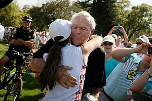 Arnold Palmer plucked Catherine Yaun of Clermont from the crowd and gave her an autographed driver in Round 3 of the Arnold Palmer Invitational at Bay Hill Lodge and Club.