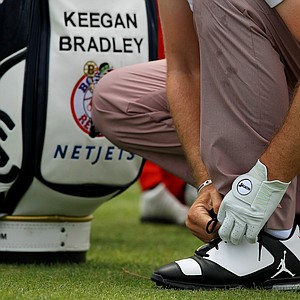 Keegan Bradley ties his Nike Jumpman golf shoes, a part of the Air Jordan brand in Round 3 of the Arnold Palmer Invitational at Bay Hill Lodge and Club.