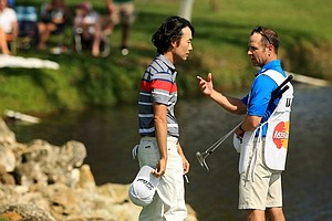 Kevin Na with his caddie Kenny Harms after Round 3 of the Arnold Palmer Invitational at Bay Hill Lodge and Club.