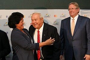 Arnold Palmer and Nancy Lopez share a laugh during a World Golf Hall of Fame press conference at the final round of the Arnold Palmer Invitational at Bay Hill Lodge and Club. In the background is Jack Peter, chief operating office of the World Golf Hall of Fame.