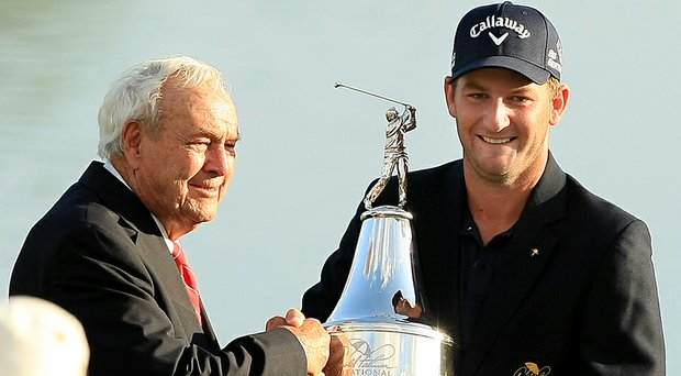 After his first PGA Tour victory, Matt Every accepts the trophy from Arnold Palmer at his namesake invitational at Bay Hill Club and Lodge in Orlando, Fla.