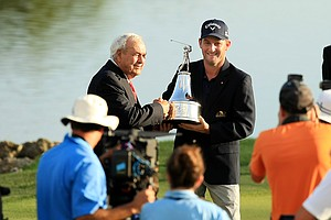 Arnold Palmer and Matt Every pose for pictures after Every won the Arnold Palmer Invitational at Bay Hill Lodge and Club.