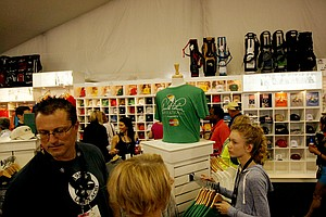 Spectators browse the merchandise tent during the final round of the Arnold Palmer Invitational at Bay Hill Lodge and Club.