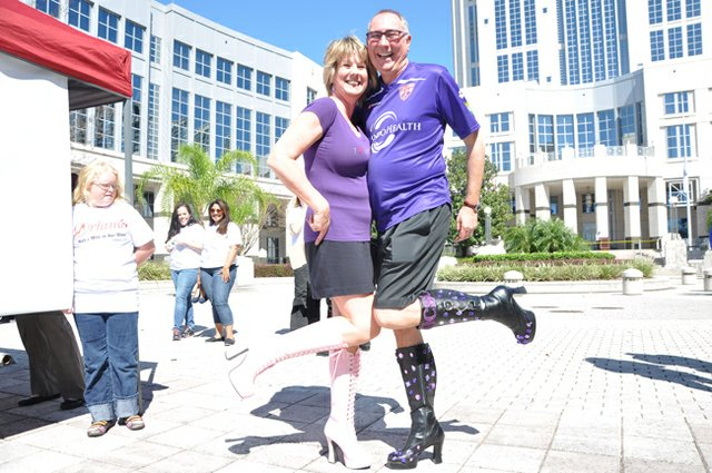 Men and women slipped on their highest heels for a walk through downtown Orlando to raise awareness of domestic violence.