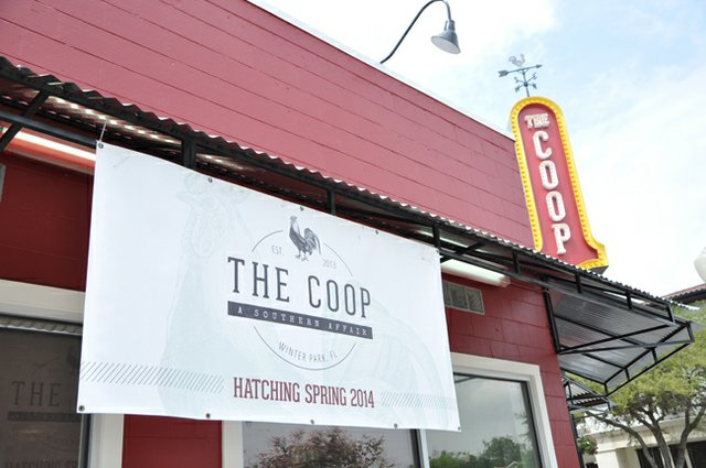 Signs of an impending opening hang over The Coop, founded by Winter Park's John Rivers.