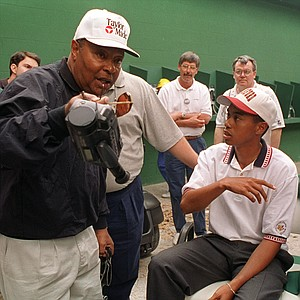 Ron Balicki in the center background with Tiger Woods, then a Stanford golfer, at front right.