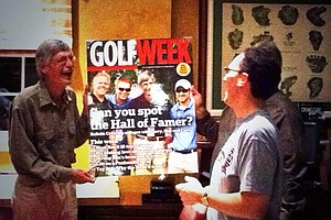 Ron Balicki, left, congratulated by Golfweek staffers including senior writer Adam Schupak.