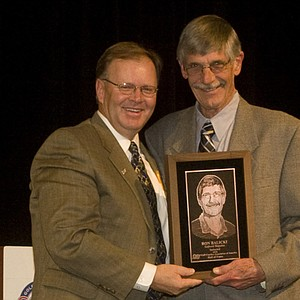 Ron Balicki (right) was the first non-coach inducted into the GCAA Hall of Fame in 2010, shown here with BYU head coach Bruce Brockbank.