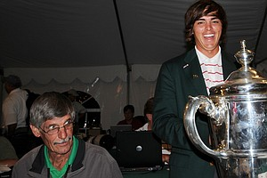 Rickie Fowler celebrates with the Walker Cup trophy while our Ron Balicki gives one of his patented looks over his glasses.