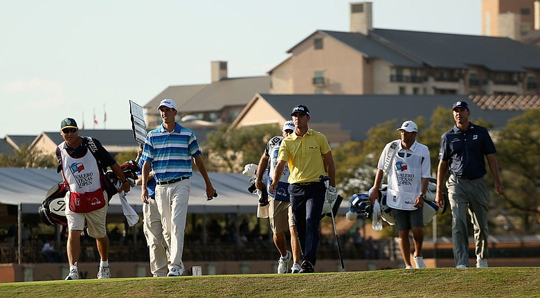 Matt Kuchar, Billy Horschel and Chesson Hadley walk from the 11th tee during the first round of the Valero Texas Open.