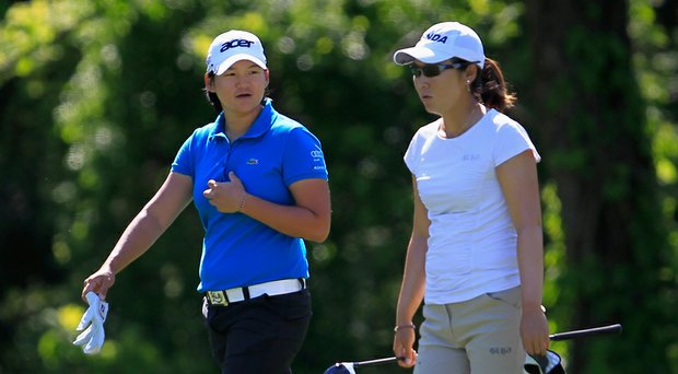 Yani Tseng, left, and Candie Kung will be teammates for Taiwan in the 2014 International Crown at Caves Valley Golf Club in Owings Mills, Md. (shown here during the 2012 Sybase Match Play).