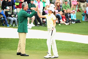 Amanda Gartrell celebrates after holing a putt on the 18th green during the National Finals of the Drive, Chip and Putt Championship at Augusta National.