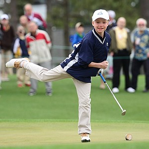 Conner Willett from Wellesley, Mass. (boys' 10-11 division) reacts after sinking his putt on the 18th hole during the National Finals of the 2014 Drive, Chip and Putt Championships.