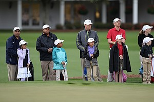 Young golfers (Girls' 7-9 division) wait for their turn to play during the National Finals of the 2014 Drive, Chip and Putt Championships at Augusta National.