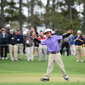 Leo Cheng from Northridge, Calif. (boys' 10-11 division) reacts after sinking his putt on the 18th hole during the National Finals of the 2014 Drive, Chip and Putt Championships at Augusta National.