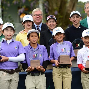 (Front, left to right) Lucy Li (Girls 10-11), Leo Cheng (Boys 10-11), Kelly Xu (Girls 7-9), Treed Huang (Boys 7-9), (Back, left to right) Natalie Pietromonaco (Girls 12-13), Bryson Bianco (Boys 12-13), Hunter Pate (Girls 14-15) and Patrick Welch (Boys 14-15) pose with their trophies after winning in their age group during the National Finals of the 2014 Drive, Chip and Putt Championships at Augusta National.