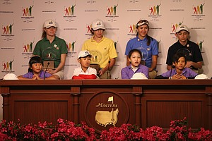 From left (front row): Kelly Xu, Treed Huang, Lucy Li, Leo Cheng; (back row) Natalie Pietromonaco, Bryson Bianco, Hunter Pate and Patrick Welch face the media after winning their divisions in the National Finals of the Drive, Chip and Putt Championship at Augusta National.