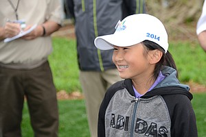 NIne-year-old Kelly Xu won the 7-9 girls' division of the inaugural Drive, Chip and Putt contest at the finale at Augusta National.
