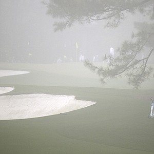 K.J. Choi gets in some Masters prep before rough weather forced an early end to practice Monday at Augusta National.