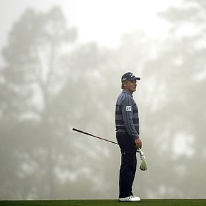 Bernhard Langer gets in some Masters prep before rough weather forced an early end to practice Monday at Augusta National.