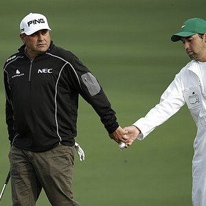 Angel Cabrera and his caddie, son Angel Cabrera Jr., during a practice round for the Masters Tuesday at Augusta (Ga.) National Golf Club.