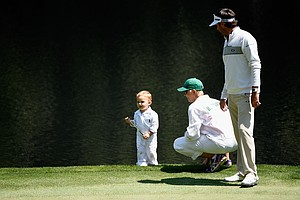 Bubba Watson with son Caleb and wife Angie during Wednesday's Par-3 Contest at Augusta National on the eve of the Masters.