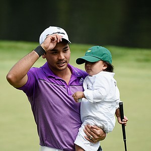 Jason Day with son Dash during Wednesday's Par-3 Contest at Augusta National on the eve of the Masters.
