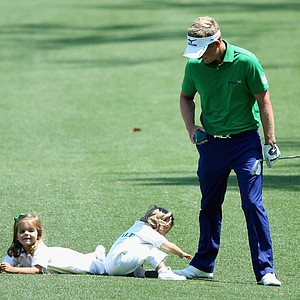 Luke Donald with daughters Elle and Sophia Ann during Wednesday's Par-3 Contest at Augusta National on the eve of the Masters.