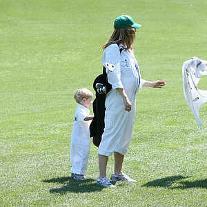 Webb Simpson with son James and wife Dowd during Wednesday's Par-3 Contest at Augusta National on the eve of the Masters.