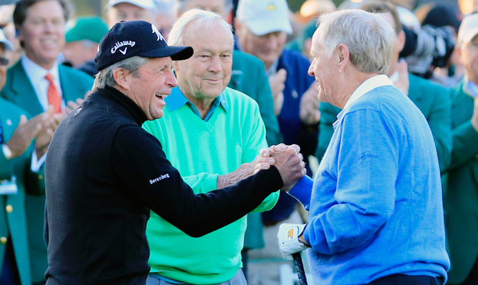 Honorary starters Gary Player, Arnold Palmer and Jack Nicklaus greet each other on the first tee at the start of the first round of the 2014 Masters.