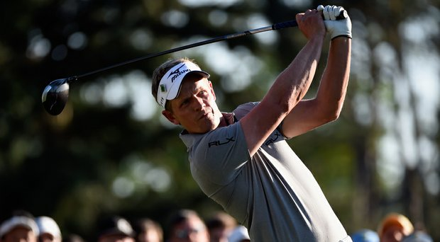 Luke Donald received a two-stroke penalty for touching the sand with his club in between shots.