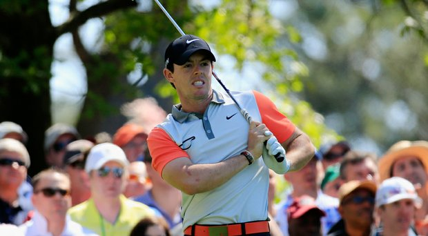 Rory McIlroy fired a 1-under 71 to sit three shots off the lead at the Masters.