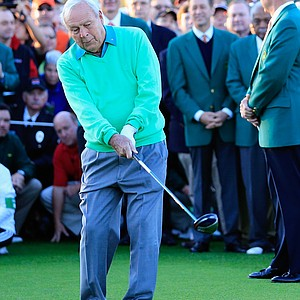 Arnold Palmer hits a ceremonial tee shot to start Thursday's first round of the 2014 Masters at Augusta National.