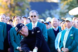 Gary Player hits a ceremonial tee shot to start Thursday's first round of the 2014 Masters at Augusta National.