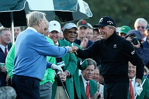 Jack Nicklaus, left, and Gary Player shake hands as Arnold Palmer looks on before the ceremonial tee shots to start Thursday's first round of the 2014 Masters at Augusta National.