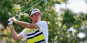 Watson mixes, matches way to Masters lead