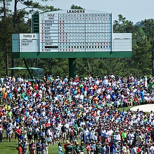 The crowds at Augusta National look on at Bubba Watson's tee shot during Saturday's third round of the 2014 Masters.