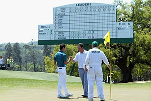 Rory McIlroy and marker Jeff Knox during Saturday's third round of the 2014 Masters at Augusta National.