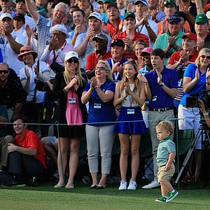 Caleb Watson, 2, walks toward his father, Bubba, at the back of the 18th green during the 2014 Masters.